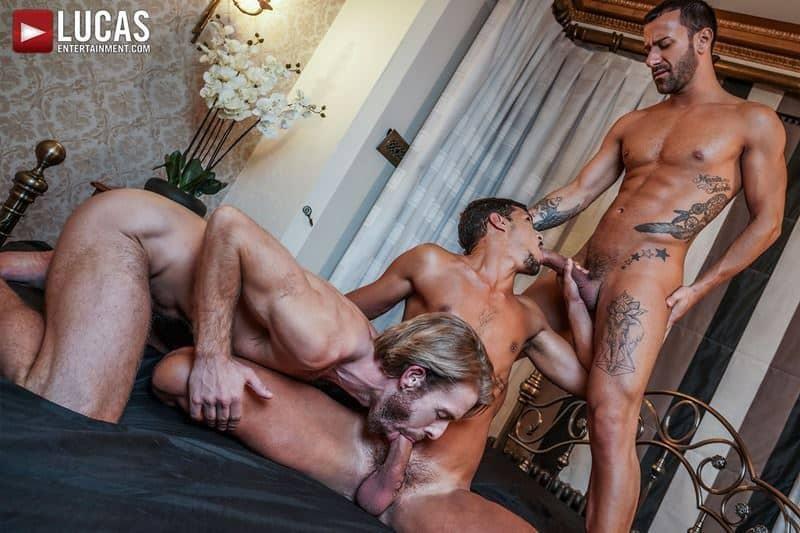 Horny muscle hunks Gustavo Cruz and Gabriel Phoenixs' huge uncut dicks bareback fuck Ray Crosswell's holes
